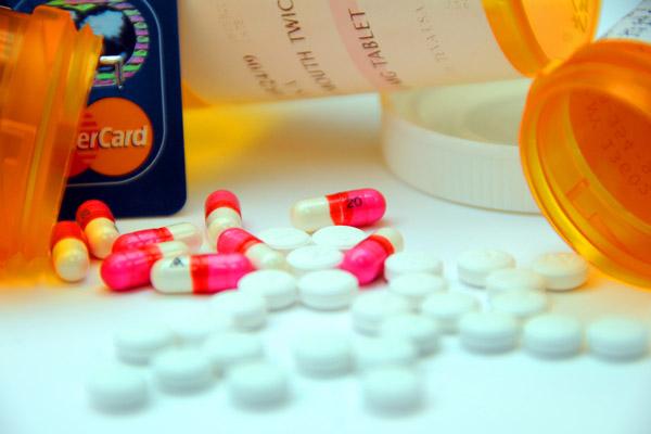 Prescription drugs and visa card.