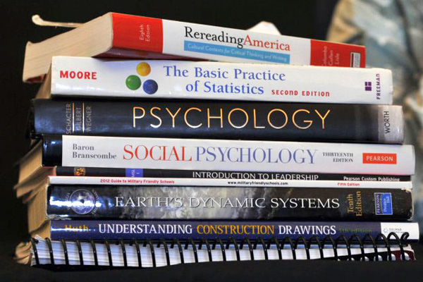 Stack of eight textbooks.