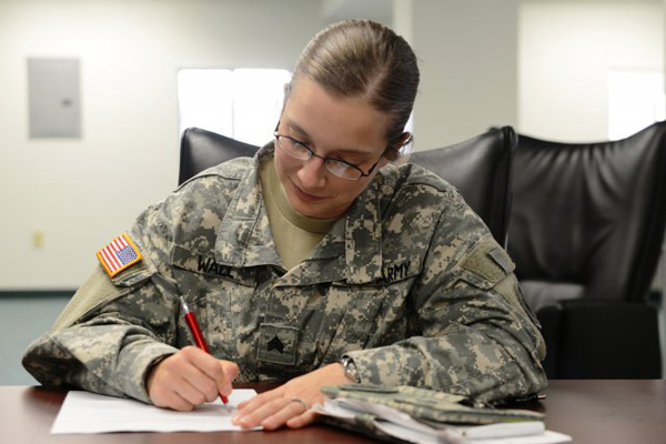 Soldier wearing glasses taking test.