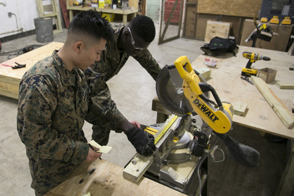 Cpl. Jun Lin, a Marine in a wood working shop.