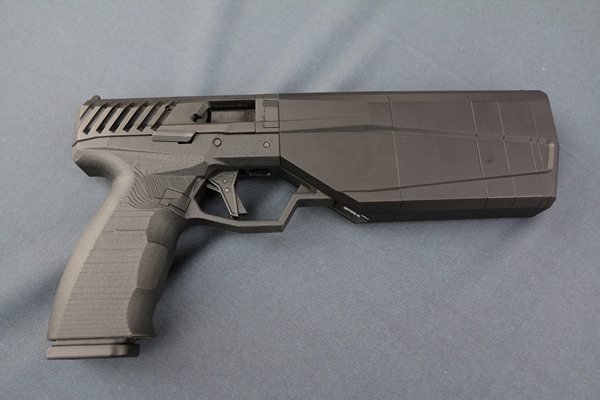 SilencerCo turned heads at SHOT Show in Las Vegas on Jan. 18, 2016, with its latest prototype of the Maxim 9, an integrally suppressed 9mm handgun available for sale later this year. (Photo by Brendan McGarry/Military.com)