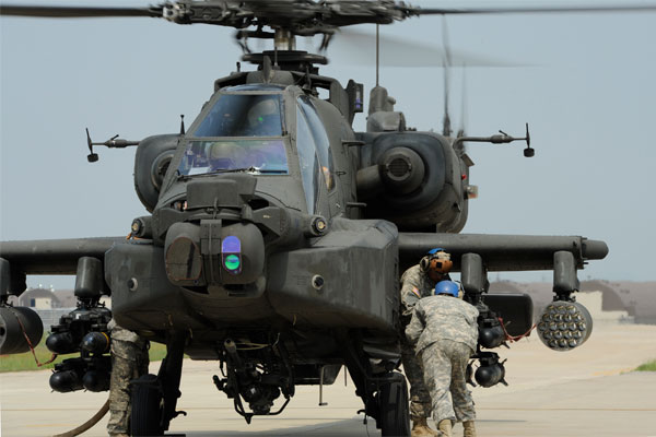 Helicopter crew chiefs load a Hellfire missile onto an AH-64 Apache attack helicopter. Cuba has returned an inert training version of the missile to the US. (US Air Force/Tong Duong)