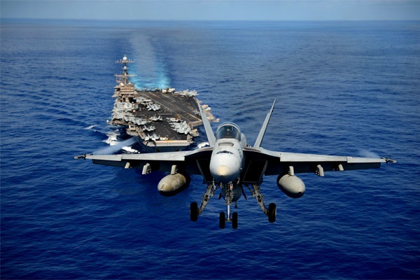 An F/A-18E Super Hornet participates in a Pacific Ocean air power demonstration over the aircraft carrier USS John C. Stennis (CVN 74) in April 2013. (US Navy/Ignacio Perez)