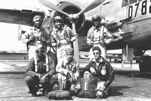 ... A Tuskegee Airman crew poses in front of a B-25. (Courtesy photo