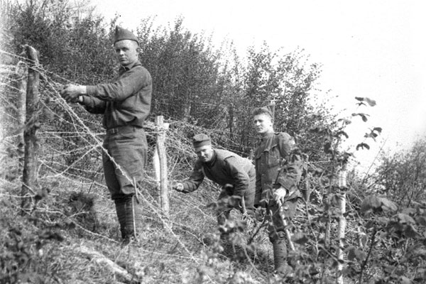 Soldiers from the 103d Infantry string wire in a training area in France in the spring of 1918. (Photo: Maine National Guard Archives)