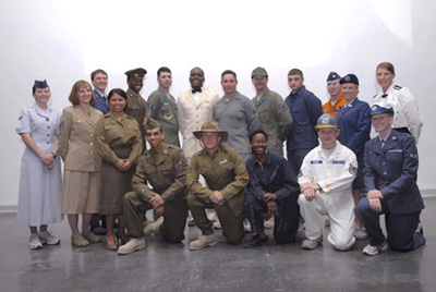 Group shot of Airmen featuring historical Air Force uniforms.
