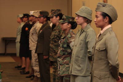 Marines showcasing historical female uniforms.