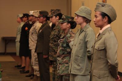 Marines showcasing historical female uniforms.