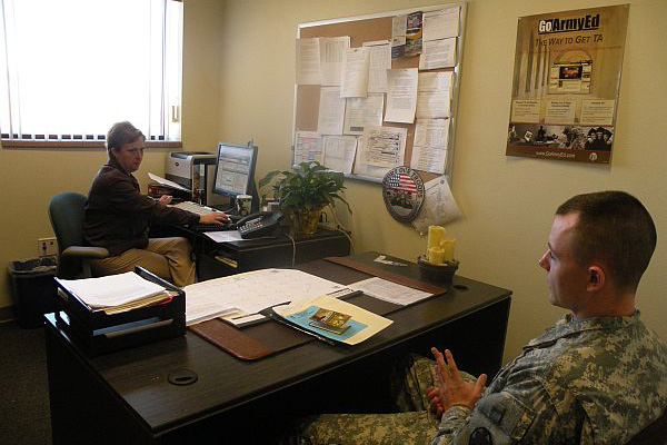 Servicemember in counseling office.