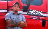 Roehl Transport trucker in front of cab door