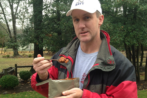 Stew Smith eating an MRE.