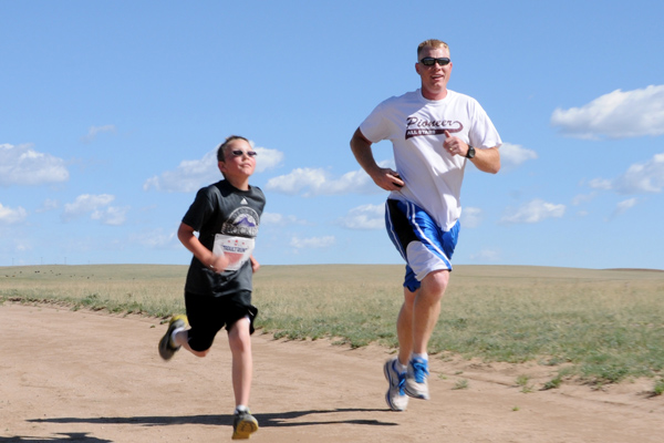 Father and son running.