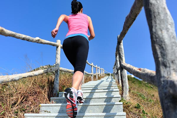 Jogging up stairs.