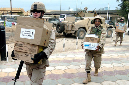 soldiers carrying boxes