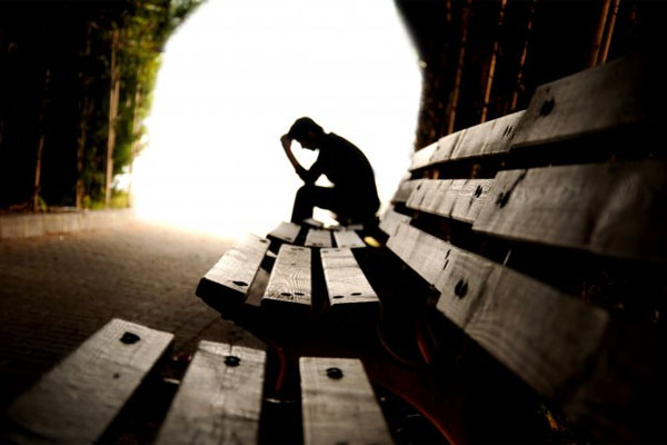 depressed person on bench