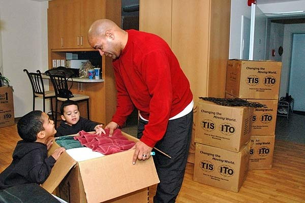 Father and children packing for a move. (U.S. Army photo)