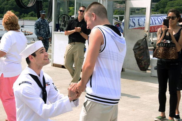 Petty Officer 2nd Class Jerrel Revels, left, proposes to his boyfriend Dylan Kirchner during the homecoming of the USS New Mexico at the submarine base in Groton, Conn.