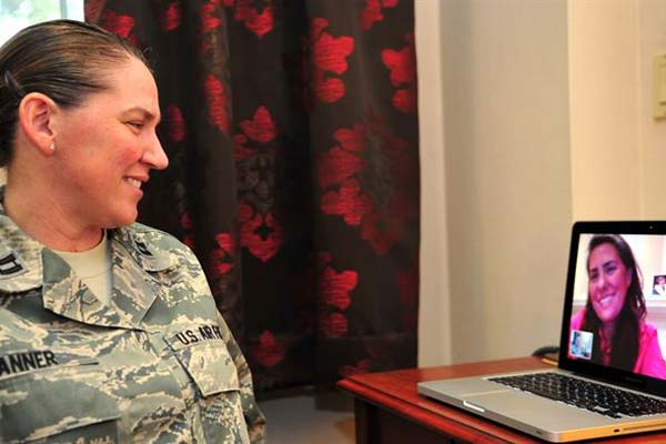Capt. Dawn Tanner, 51st Medical Operations Squadron Family Advocacy element leader, Facetimes her wife, Dana McCown, retired lieutenant colonel, at Osan Air Base, Republic of Korea, Sept. 13, 2013. (U.S. Air Force Photo/Airman 1st Class Ashley J. Thum)