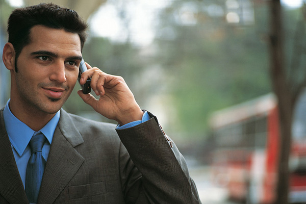 Businessman using a cell phone.