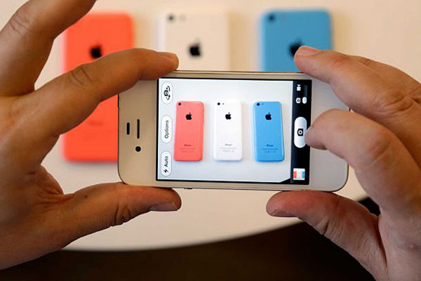 Apple debuts its new iPhones, which will come in a bevy of colors and two distinct designs, one made of plastic.