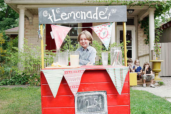 child with lemonade stand