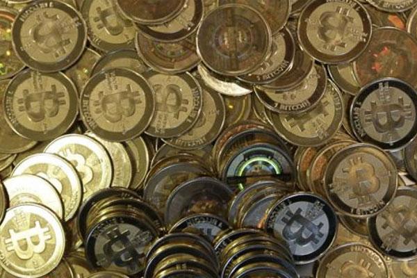 This April 3, 2013 file photo shows bitcoin tokens in Sandy, Utah. (AP Photo/Rick Bowmer, File)