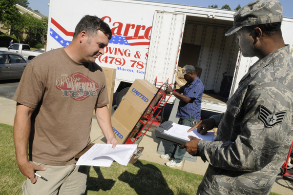 An Airman works with a moving crew during a PCS.