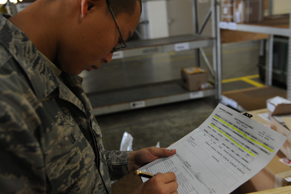 A Soldier looks over some paperwork.