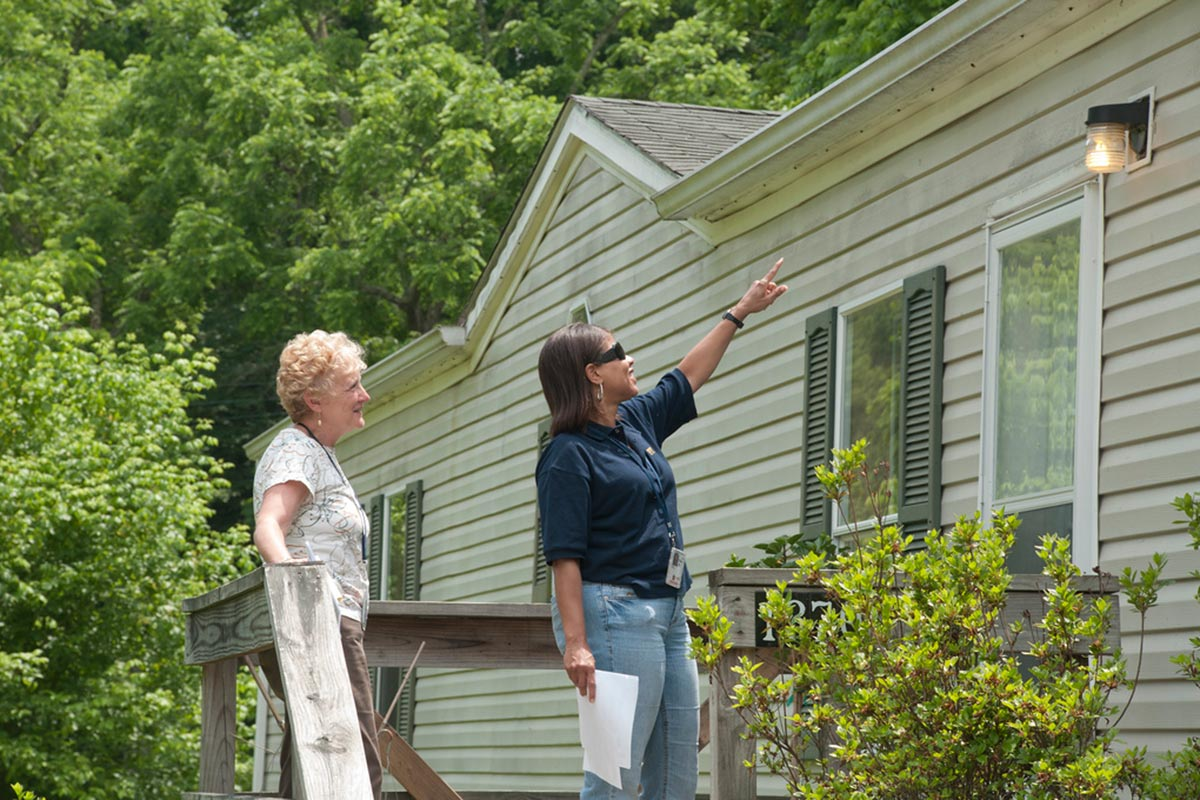 Two specialists inspect a home