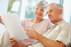 A couple looks over retirement planning documents.