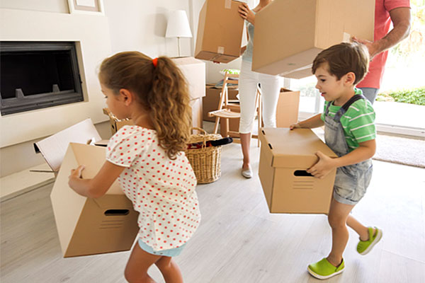 Children with moving boxes