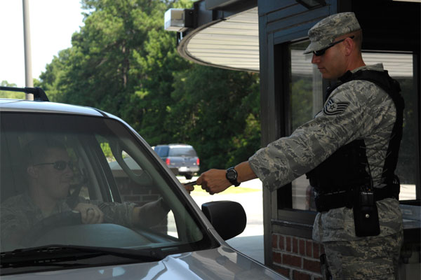 Bases In North America Tech Sgt Brian Saylors Checks An Identification Card At The Back Gate On Joint