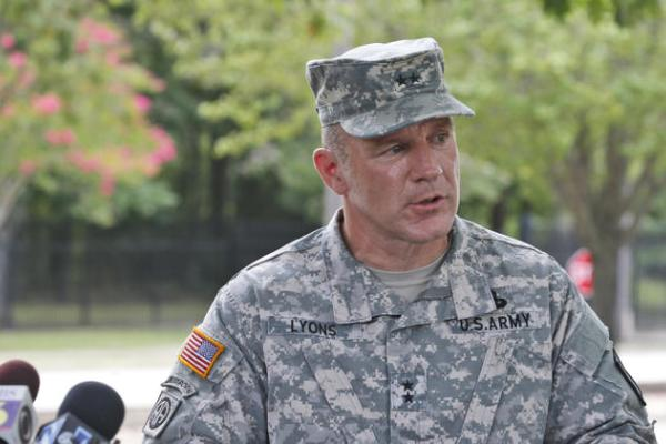 Army Maj. Gen. Stephen Lyons speaks during a news conference at the base in Fort Lee, Va., Monday, after a female soldier with a gun inside a key building at a Virginia Army base turned the weapon on herself. (AP Photo/Steve Helber)