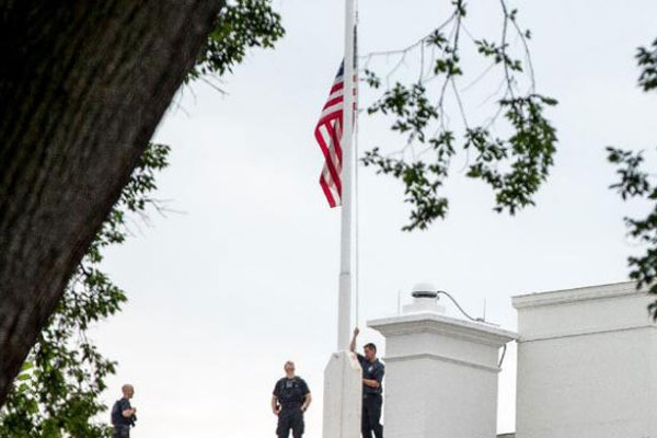 The American flag is lowered to half-staff above the White House in Washington, Tuesday, July 21, 2015, to honor the five U.S. service members who were killed by a gunman in Chattanooga, Tenn. last week (AP Photo/Andrew Harnik)