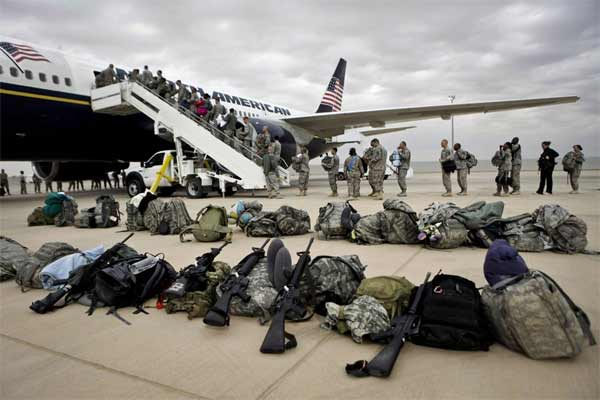 In this Tuesday, Nov. 1 , 2011 file photo, U.S. soldiers begin their journey home at al-Asad airbase, west of Baghdad, Iraq.