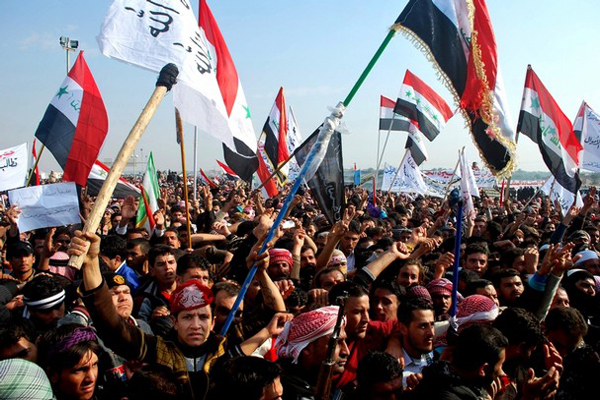 Protesters chant slogans against Iraq's Shiite-led government in Ramadi, 70 miles west of Baghdad on Sunday, Dec. 30, 2012. Gunshots wounded at least two people Sunday at demonstrations in western Iraq. (AP Photo)