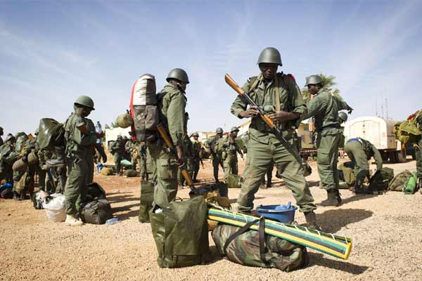 shows Malians soldiers arriving at Gao airport, north of Mali, Saturday, Jan. 26, 2013.
