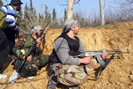 Free Syrian Army fighters take their positions during clashes with government forces in Qusair, Homs province, Syria, Sunday, Jan. 20, 2013.