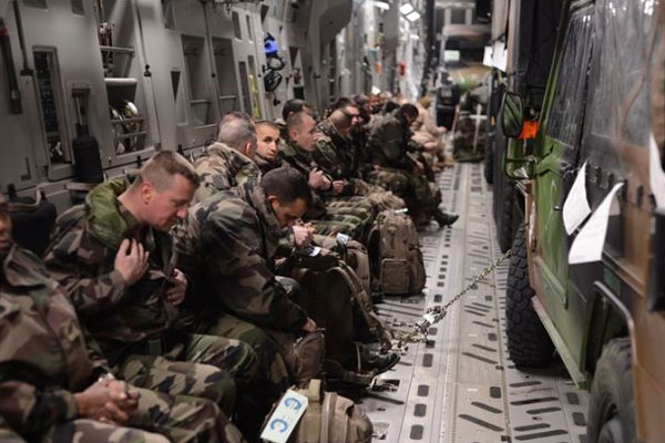 French troops prepare for take-off inside a U.S. Air Force C-17 Globemaster in Istres, France. The U.S. aided the French in moving a mechanized infantry battalion into Mali to fight al-Qaida.