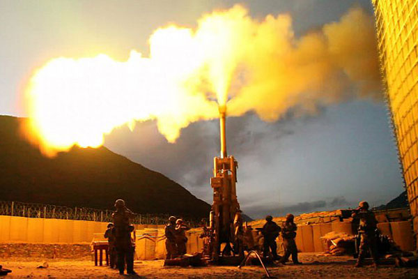 Soldiers with Battery C, 1st Battalion, 321st Airborne Field Artillery Regiment, 18th Fires Brigade, 82nd Airborne Division, fire 155mm rounds using an M777 Howitzer weapons system, on Forward Operating Base Bostick, Afghanistan. Credit Spc. Evan D. Marcy