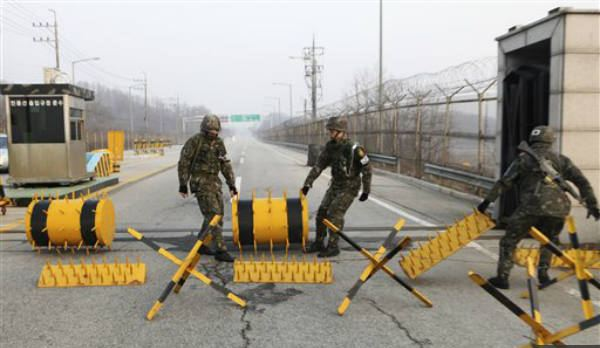 South Korean soldiers move barricades to pass vehicles at a check point in Paju, South Korea, near the border village of Panmunjom. The North says its military has been cleared to strike the U.S. with nuclear weapons if war breaks out. Ahn Young-joon/AP