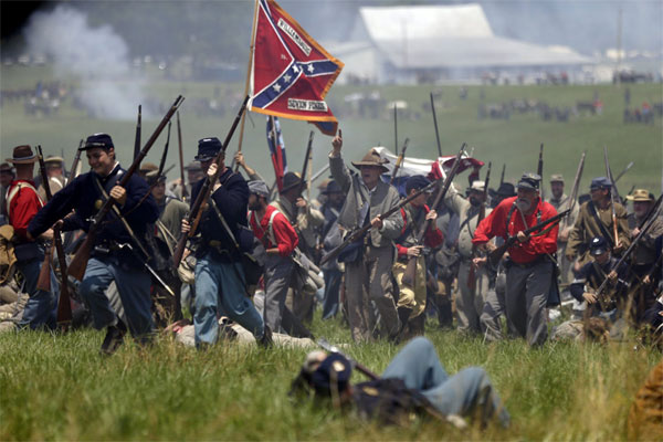 Re-enactors perform Pickett's Charge during ongoing activities commemorating the 150th anniversary of the Battle of Gettysburg, Sunday, June 30, 2013, at Bushey Farm in Gettysburg, Pa. (AP Photo/Matt Rourke)