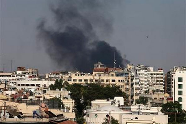 Black columns of smoke rise from heavy shelling in the Jobar neighborhood, east of Damascus, Syria.