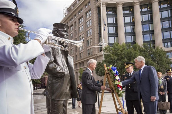 Defense Secretary Chuck Hagel, right, and Joint Chiefs Chairman Gen. Martin Dempsey, second from right, present a wreath at the Navy Memorial in Washington to remember the victims of Monday's deadly shooting at the Washington Navy Yard, Tuesday, Sept. 17.