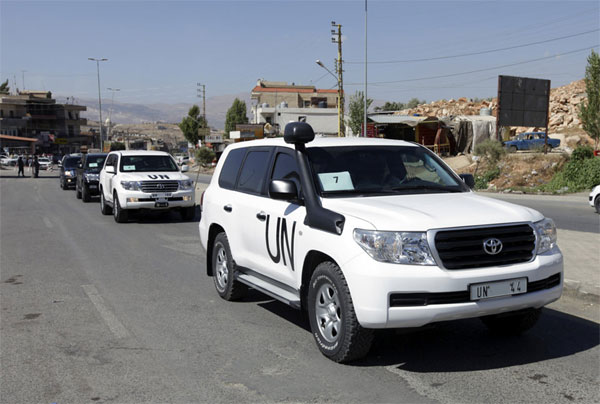 A convoy of inspectors from the Organization for the Prohibition of Chemical Weapons prepares to cross into Syria at the Lebanese border crossing point of Masnaa, eastern Bekaa Valley, Lebanon, Tuesday, Oct. 1, 2013.