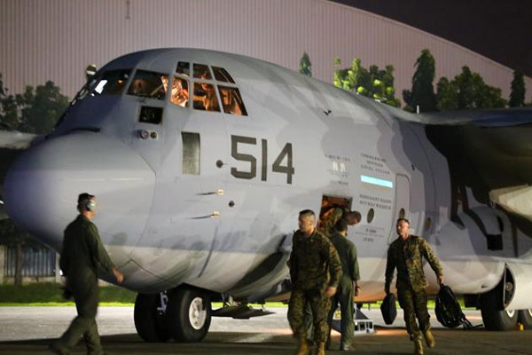 U.S. Marines from the 3rd Marine Expeditionary Brigade on two KC-130J Super Hercules aircraft arrive at Villamor Air Base, in Pasay city, metro Manila November 10, 2013.