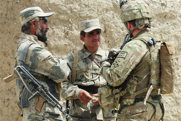 Caption: Two Afghan Border Policemen speak with 1st Lt. Patrick Ryan, with Security Assistance Team 8, during Operation Southern Strike II near the P'sha Pass in Afghanistan. (U.S. Army photo)