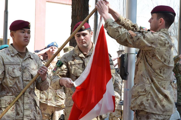 The army takes down the Canadian flag for the last time in Afghanistan bringing an end to 12 years of military involvement, Wednesday March 12, 2014, in Kabul, Afghanistan. (AP Photo/The Canadian Press, Murray Brewster)