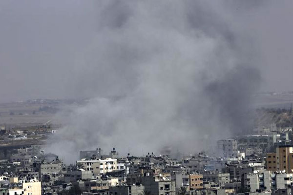 Smoke from Israeli strikes rises over Gaza City, in the northern Gaza Strip, in the northern Gaza Strip, Wednesday, July 30, 2014. (AP Photo/Adel Hana)