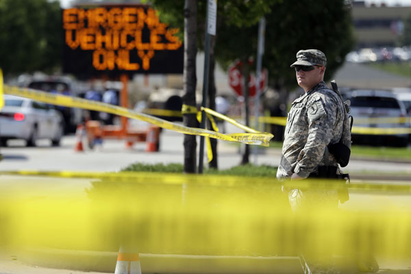 A member of the Missouri National Guard stands guard at a police command post Tuesday, Aug. 19, 2014, in Ferguson, Mo. (AP Photo/Jeff Roberson)